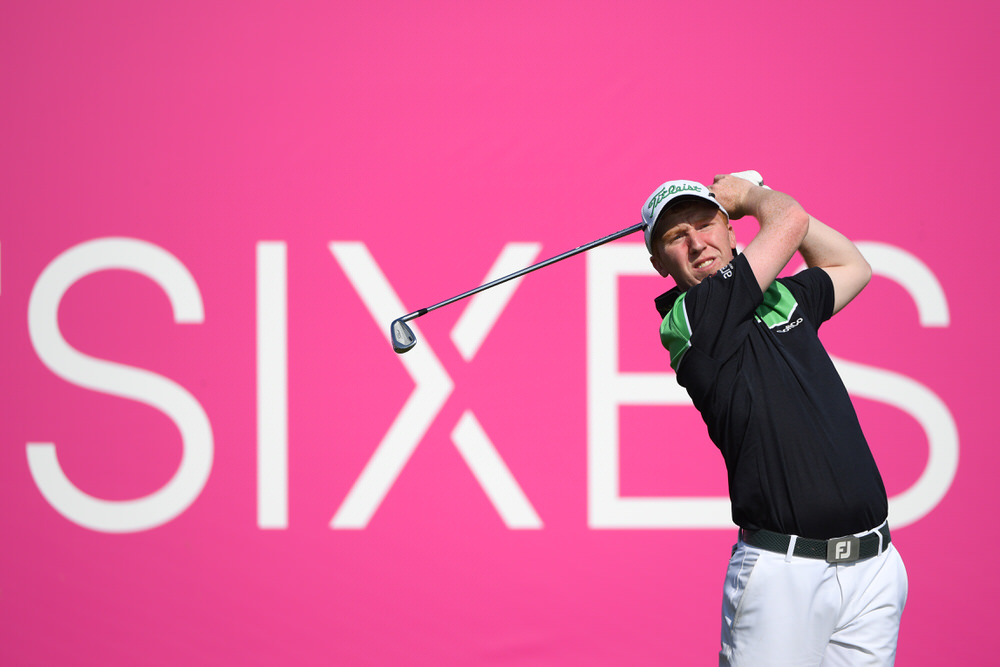 Gavin Moynihan of Ireland tees off during his semi-final match during day two of the GolfSixes at The Centurion Club on May 6, 2018 in St Albans, England. Photo by Ross Kinnaird/Getty Images