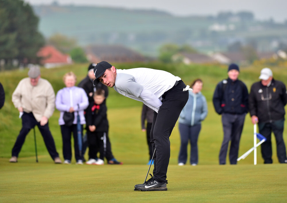 Alex Fitzpatrick (England) reacts to a missed putt on the 18th green during the final day of the Flogas Irish Amateur Open Championship at Royal County Down. Picture by  Pat Cashman