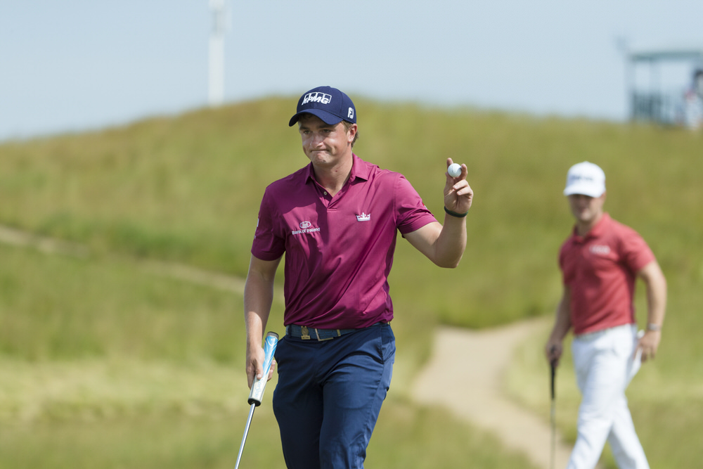 Paul Dunne waves to the gallery after making a birdie on the ninth hole during the first round of the 2017 U.S. Open at Erin Hills. ©USGA/Jeff Haynes
