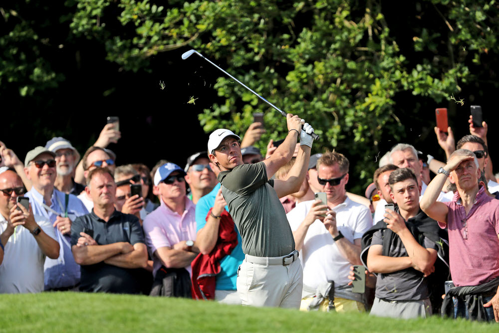Rory McIlroy of Northern Ireland plays his second shot on the par 5, 18th hole during the third round of the 2018 BMW PGA Championship on the West Course at Wentworth on May 26, 2018 in Virginia Water, England. Photo by David Cannon/Getty Images