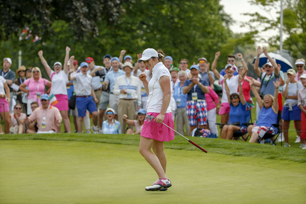 Paula Grant, along with the GB&I fans in the gallery, react as her putt dropped into the hole on the 18th hole during Morning Four-Ball Matches of the 2018 Curtis Cup at Quaker Ridge Golf Club in Scarsdale, N.Y. on Friday, June 8, 2018.  (Copyright USGA/Steven Gibbons)
