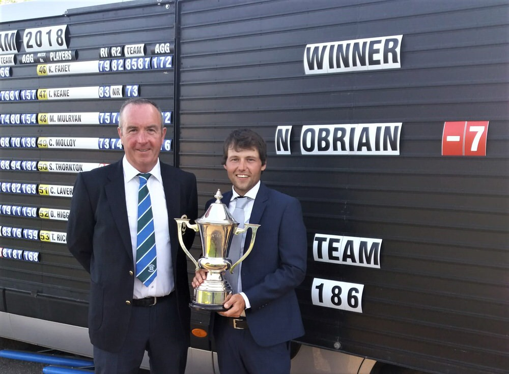Neil O'Briain with Slieve Russell captain,Ciaran Cathal