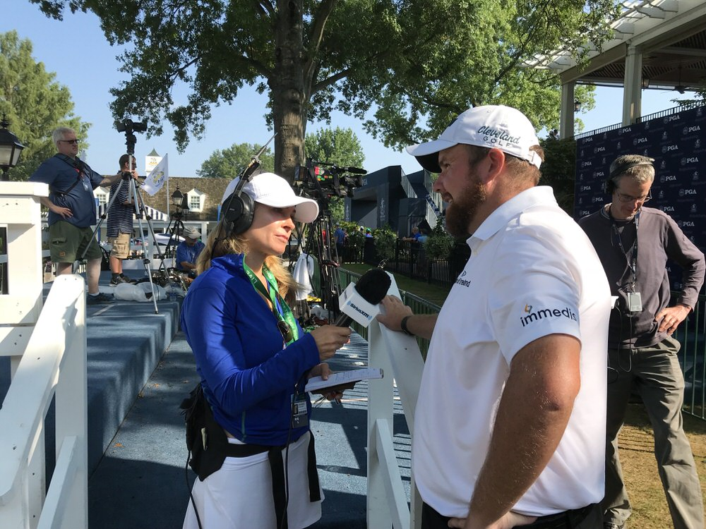 Shane Lowry speaks to the media after his round