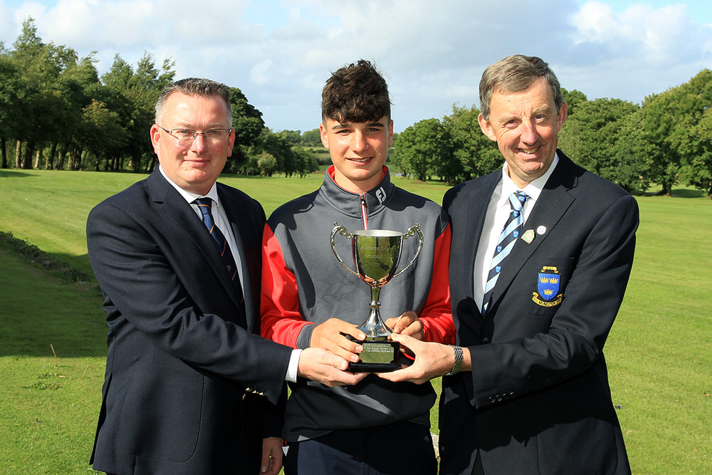 Mel Deasy (Bantry Bay) reeives the Munster Boys Under 16 Trophy from Jim Long, Chairman Munster Golf.  Also included is Alister Lynch, Captain Newcastlewest Golf Club.  Thursday 23rd August 2018.Picture: Niall O'Shea