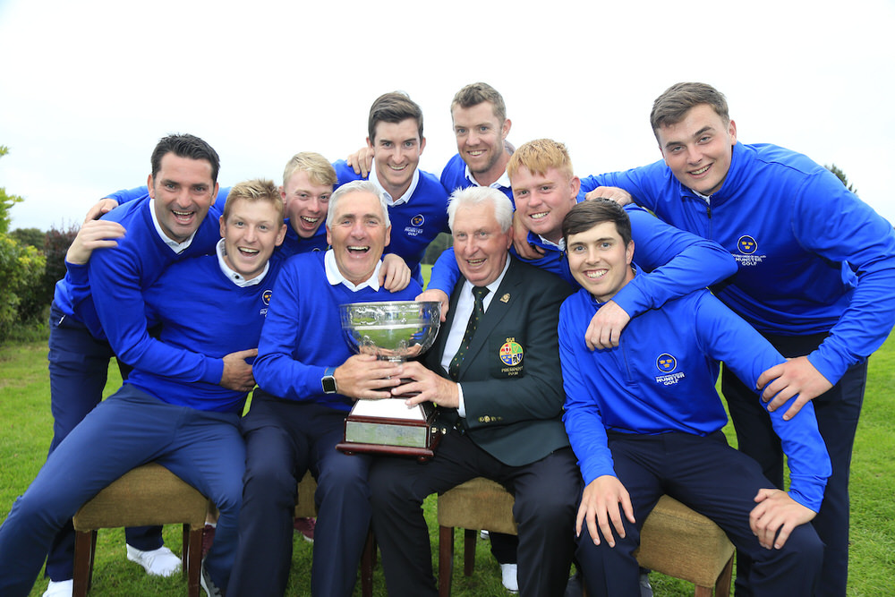 GUI President John Moloughney presents the trophy to Munster captain Michael Coote following their win in the 2018 Interprovincial Championship at Athenry.  Picture © Fran Caffrey / Golffile.ie