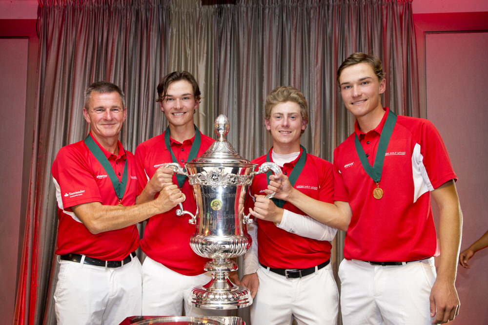 The team from Denmark poses with the Eisenhower Trophy (left to right): captain Torben Henriksen Nyehuus, Nicolai Hojgaard, John Axelsen, and Rasmus Hojgaard at the awards ceremony following the final round of stroke play at the 2018 World Amateur Team at Carton House Golf Club in Dublin, Ireland on Saturday, Sept. 8, 2018.  (Copyright USGA/Steven Gibbons)