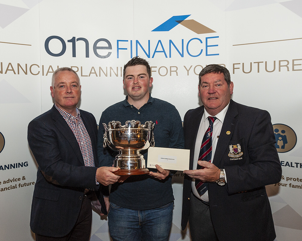 Winner Caolan Rafferty (Dundalk) receives the Dundalk Scratch Cup from Martin McDonnell (One Finance) and Gerry Byrne, Captain, Dundalk Golf Club