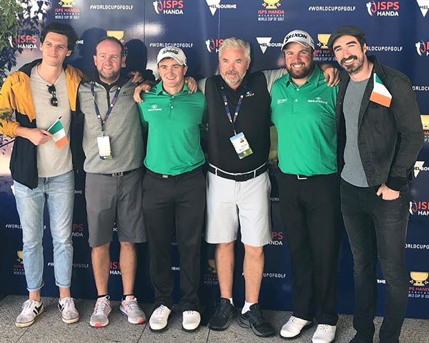 Paul Dunne and Shane Lowry with their caddies and The Coronas in Melbourne