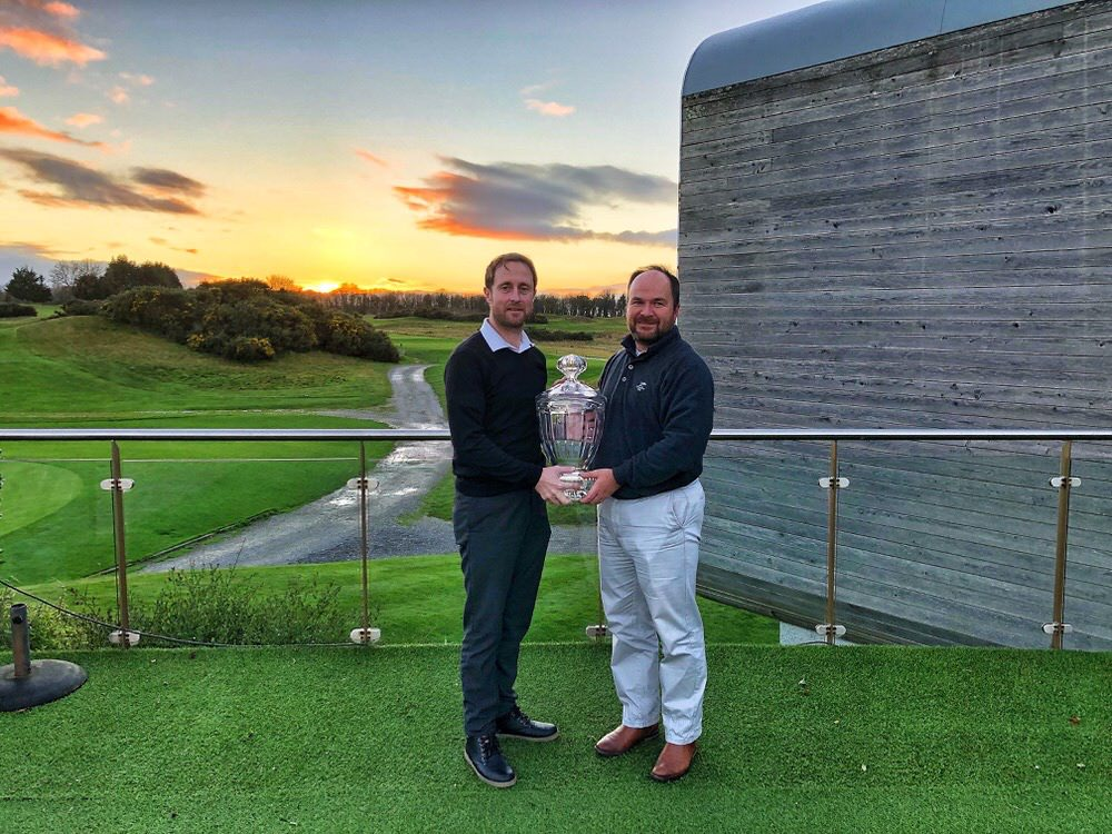 Dooks professional Dan Sugrue receives his trophy from Pádraig Dooley at Castlemartyr Resort