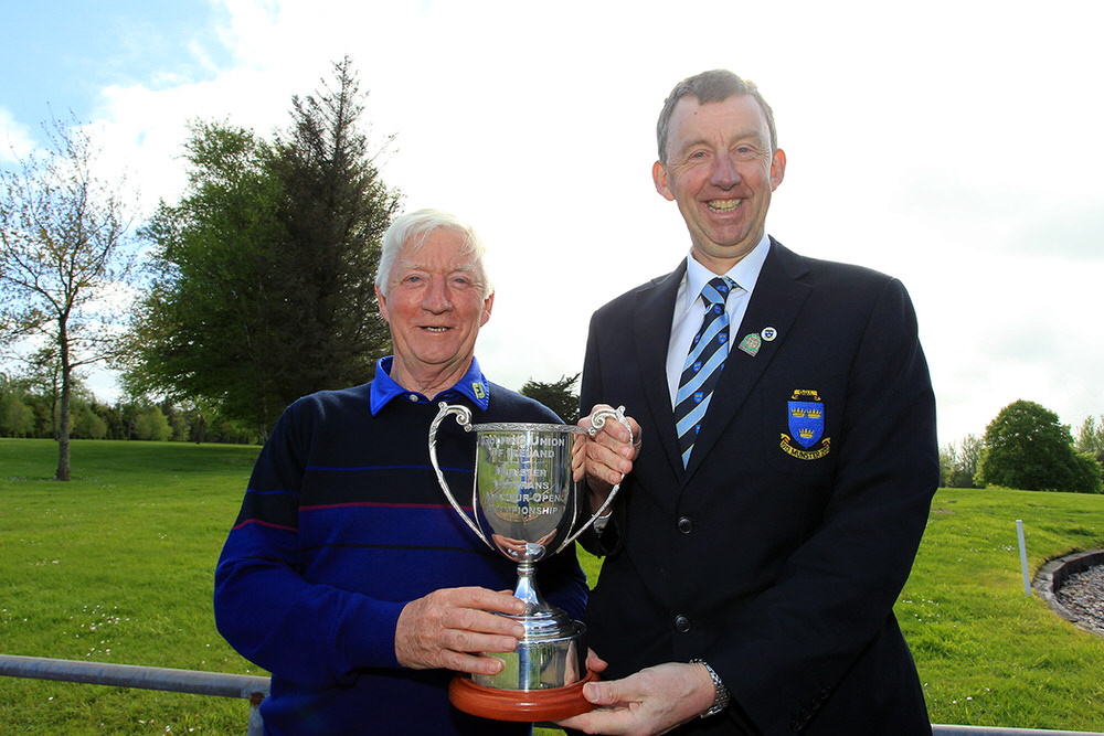 Maurice Kelly (Naas) receiving the Munster Veterans trophy from Jim Long, Chairman Munster Golf.Picture: Niall O'Shea