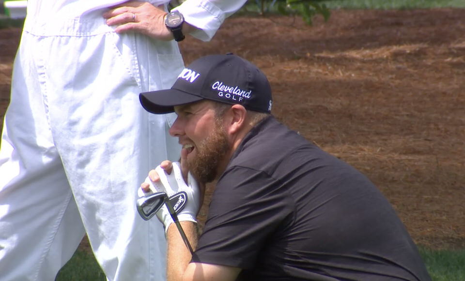 Shane Lowry sinks to his knees in disbelief as his five iron to the 11th trickles over the green.