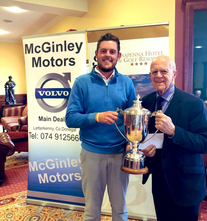 Malone's Matthew McClean receives the Rosapenna Senior Scratch Cup from sponsor Noel McGinley of McGinley Motors, Letterkenny.