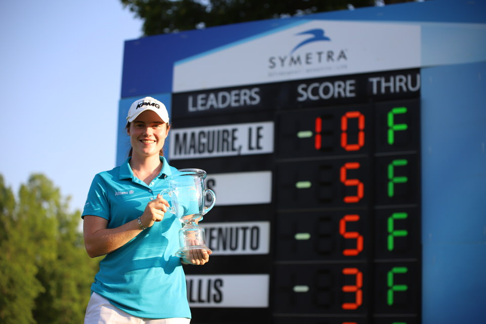 Leona Maguire with trophy at leaderboard (close).JPG