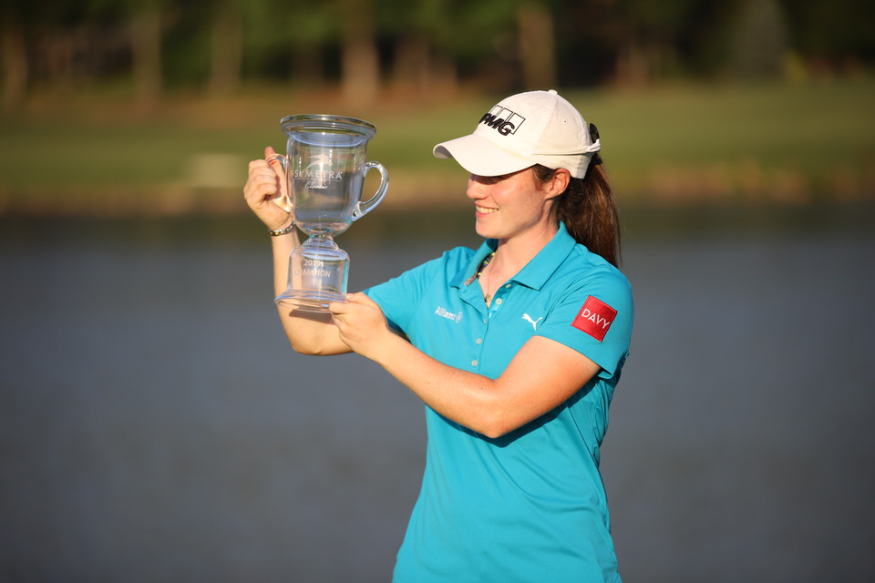 Leona Maguire looks at trophy 1.JPG