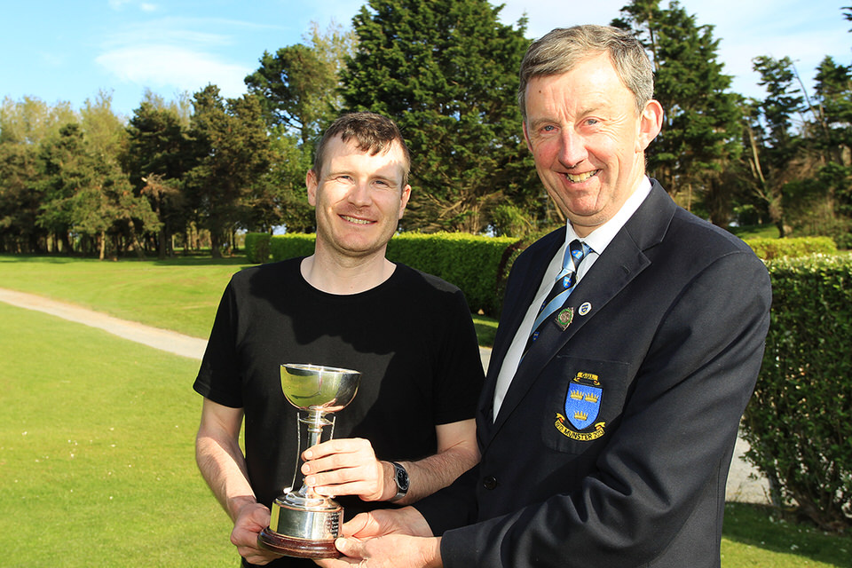 Slievenamon's Kevin Purcell receives the Munster Mid-Amateur Trophy from Jim Long, Chairman Munster Golf. Picture: Niall O'Shea