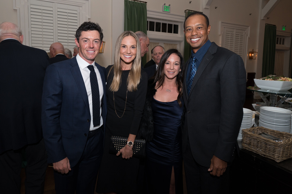 Rory McIlroy, Erica Stoll, Erica Herman and Tiger Woods pose for a photo during the Champion's Dinner for the 101st PGA Championship held at Bethpage Black Golf Course on May 14, 2019 in Farmingdale, New York. (Photo by Montana Pritchard/PGA of America)