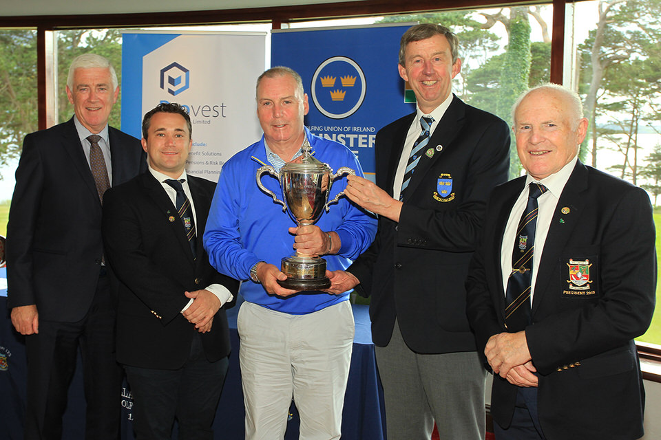 Garth McGimpsey (Royal Portrush) receiving the Munster Seniors Trophy from Jim Long, Chairman Munster Golf.  Also included is Mark O'Sullivan, Provest (sponsor), James Curran, Captain & Tom Prendergast, President, Killarney Golf & Fishing Club.