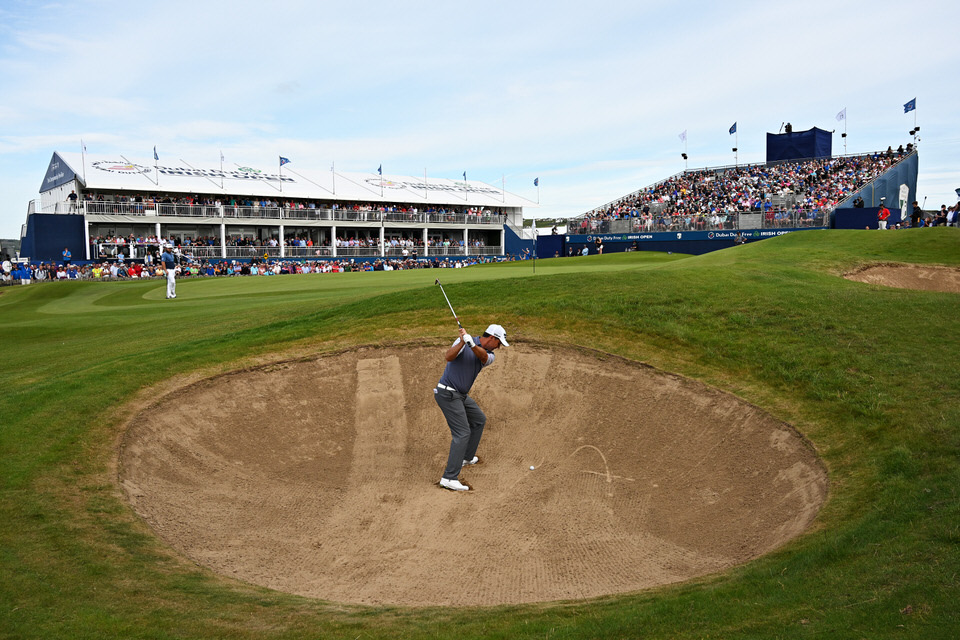 Padraig Harrington gets up and down on the 18th