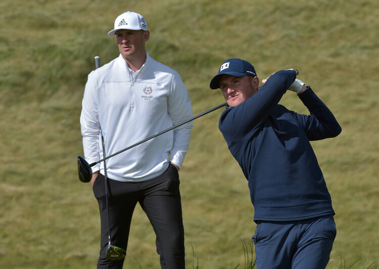 Ronan Mullarney (Ireland) driving at the second tee watched by Harry Hall (England) during day two of the 2019 Home International Matches at Lahinch Golf Club. Picture by  Pat Cashman
