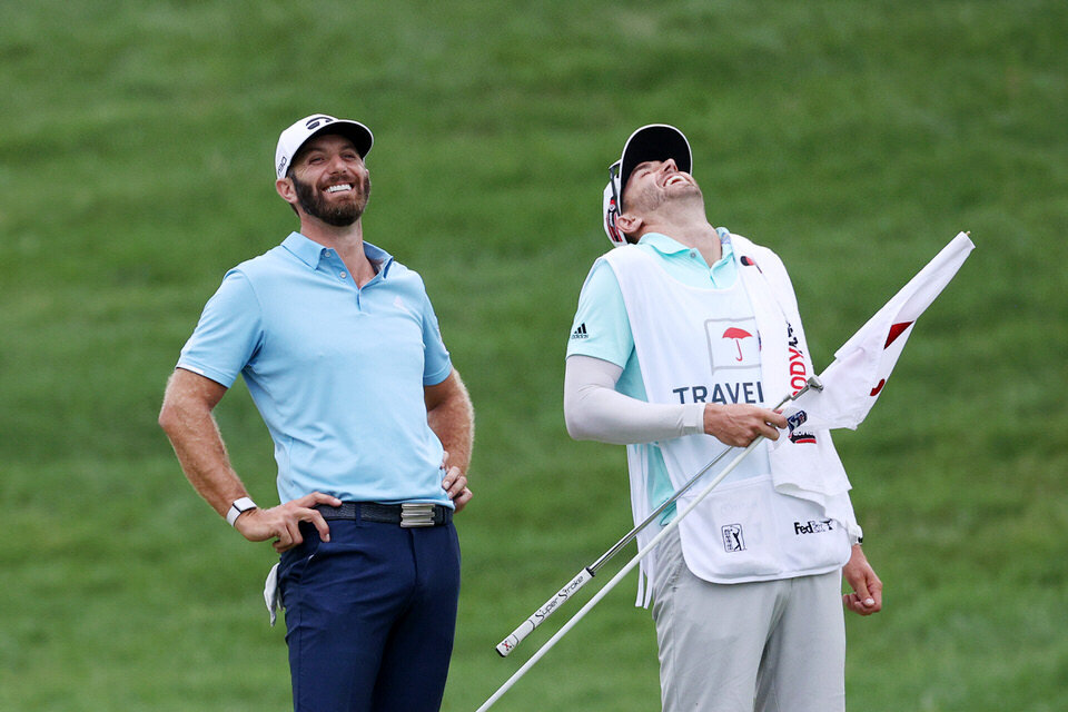 Dustin Johnsonand his brother Austin enjoy a laugh shortly after he tapped in to win the Travelers Championship at TPC River Highlands. (Photo by Rob Carr/Getty Images)