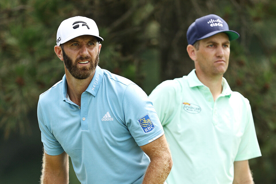 CROMWELL, CONNECTICUT - JUNE 28: Dustin Johnson of the United States and Brendon Todd of the United States stand on the fifth tee during the final round of the Travelers Championship at TPC River Highlands on June 28, 2020 in Cromwell, Connecticut. (Photo by Elsa/Getty Images)