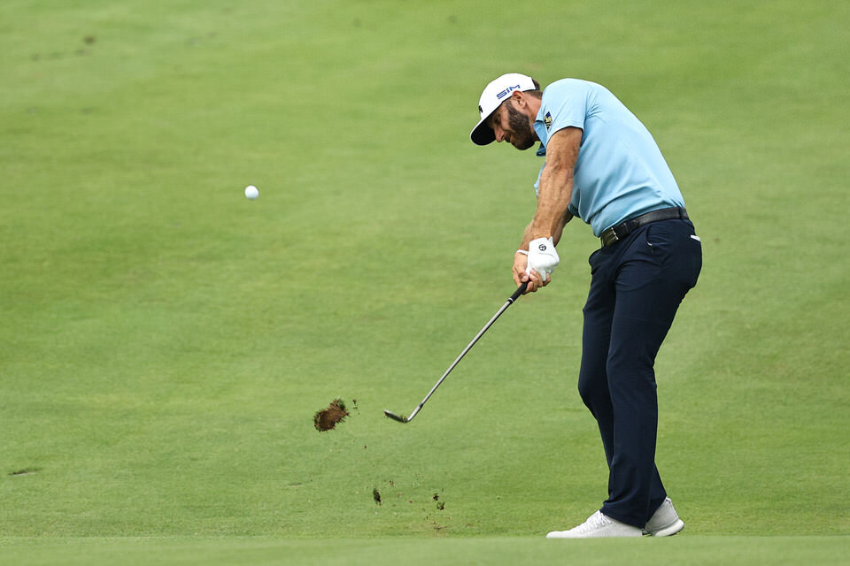 CROMWELL, CONNECTICUT - JUNE 28: Dustin Johnson of the United States plays a shot on the 18th hole during the final round of the Travelers Championship at TPC River Highlands on June 28, 2020 in Cromwell, Connecticut. (Photo by Elsa/Getty Images)