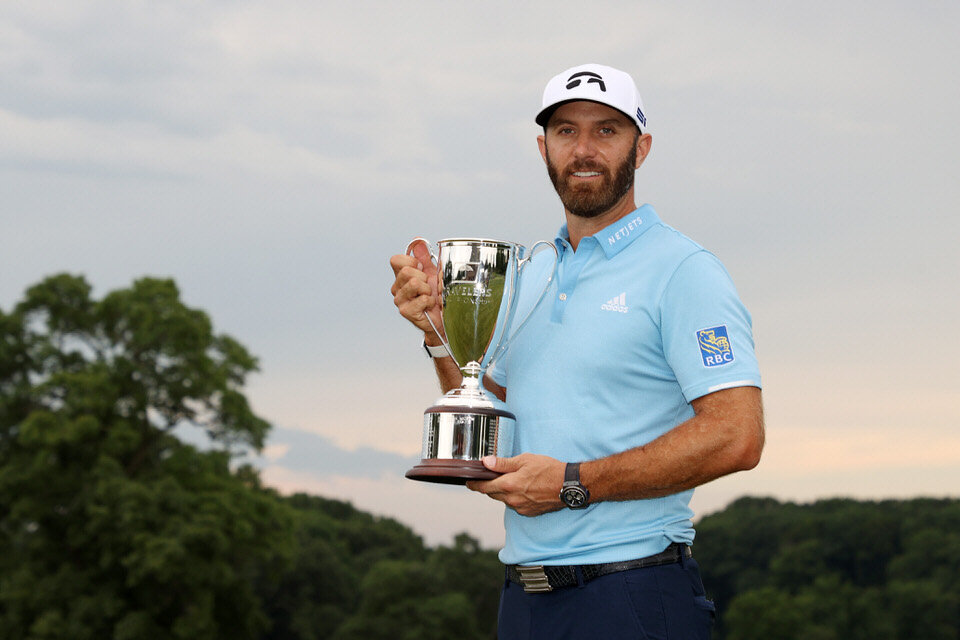 CROMWELL, CONNECTICUT - JUNE 28: Dustin Johnson of the United States poses with the trophy after winning the Travelers Championship at TPC River Highlands on June 28, 2020 in Cromwell, Connecticut. (Photo by Rob Carr/Getty Images)