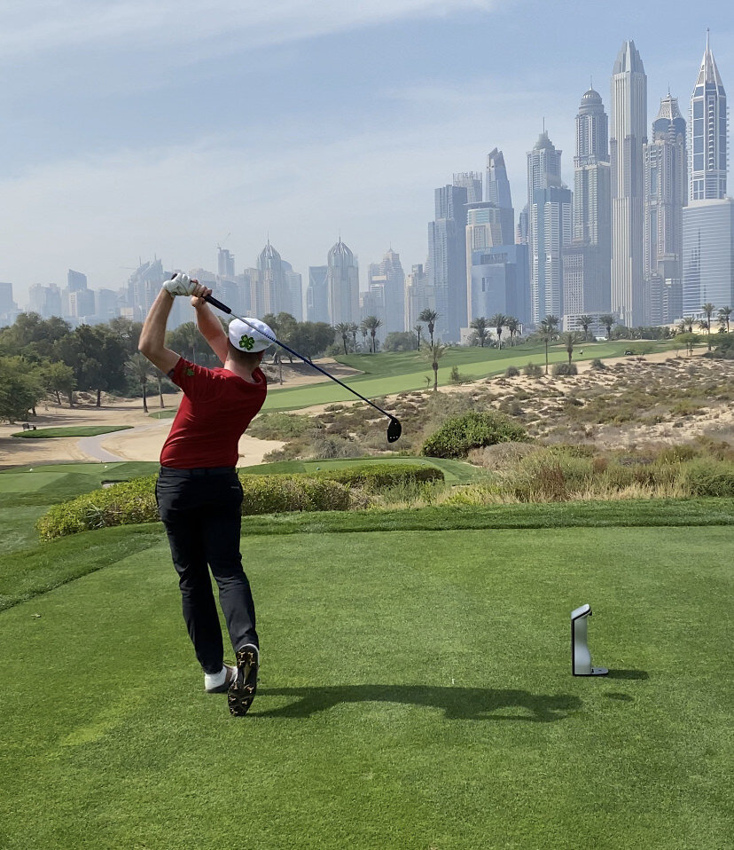 Team Ireland's David Carey drives on the eighth at the Emirates Golf Club during winter practice in Dubai