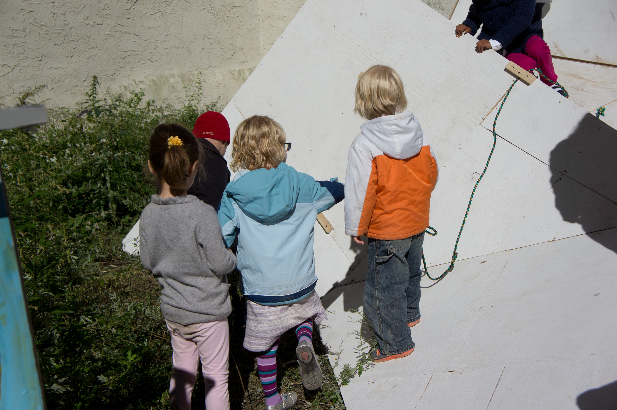 With a little aid from a father, these little ones crafted their own custom climbing wall.