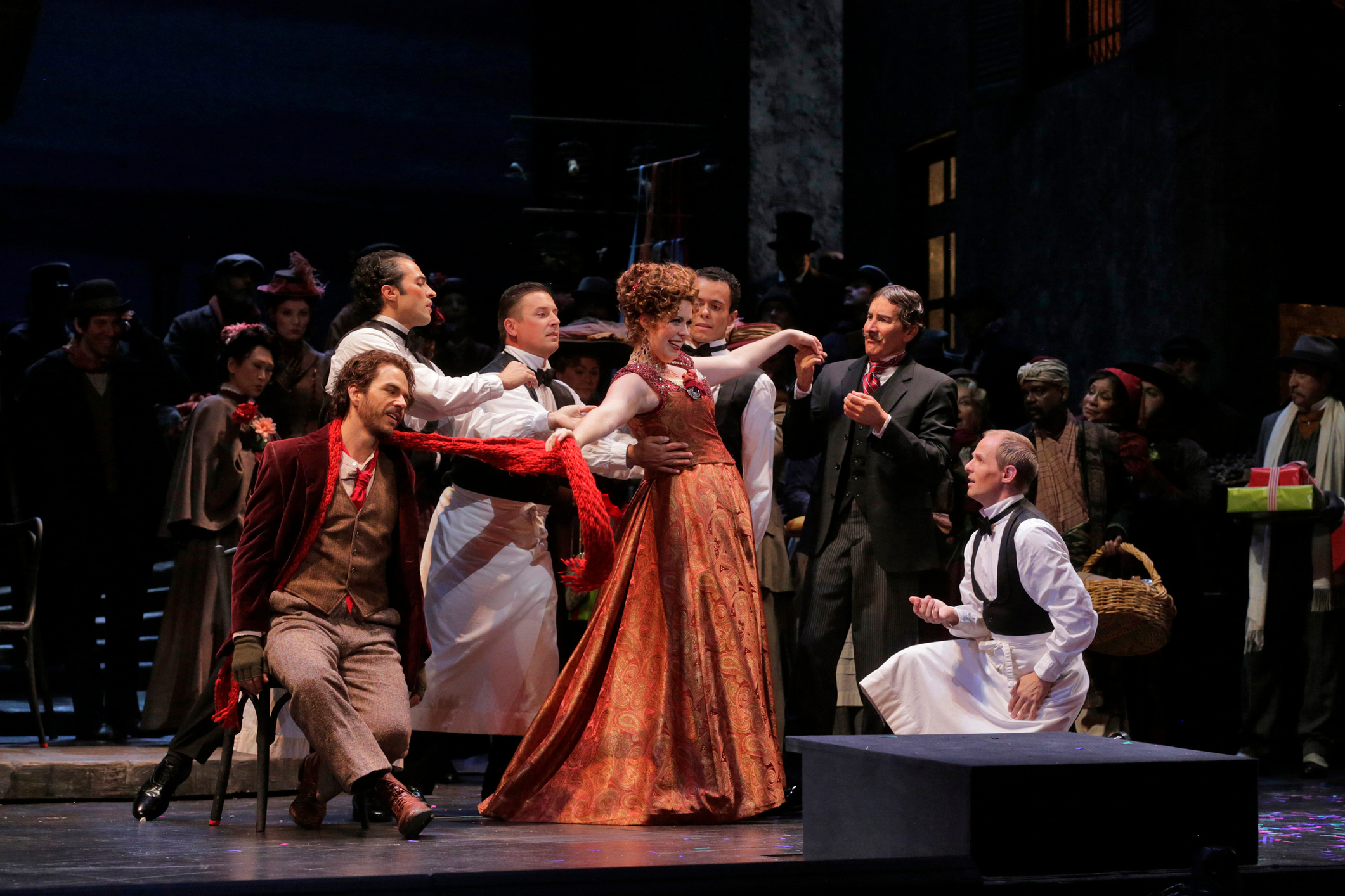 Musetta (Amanda Woodbury) and her helpless admirers. — Photography by  Ken Howard