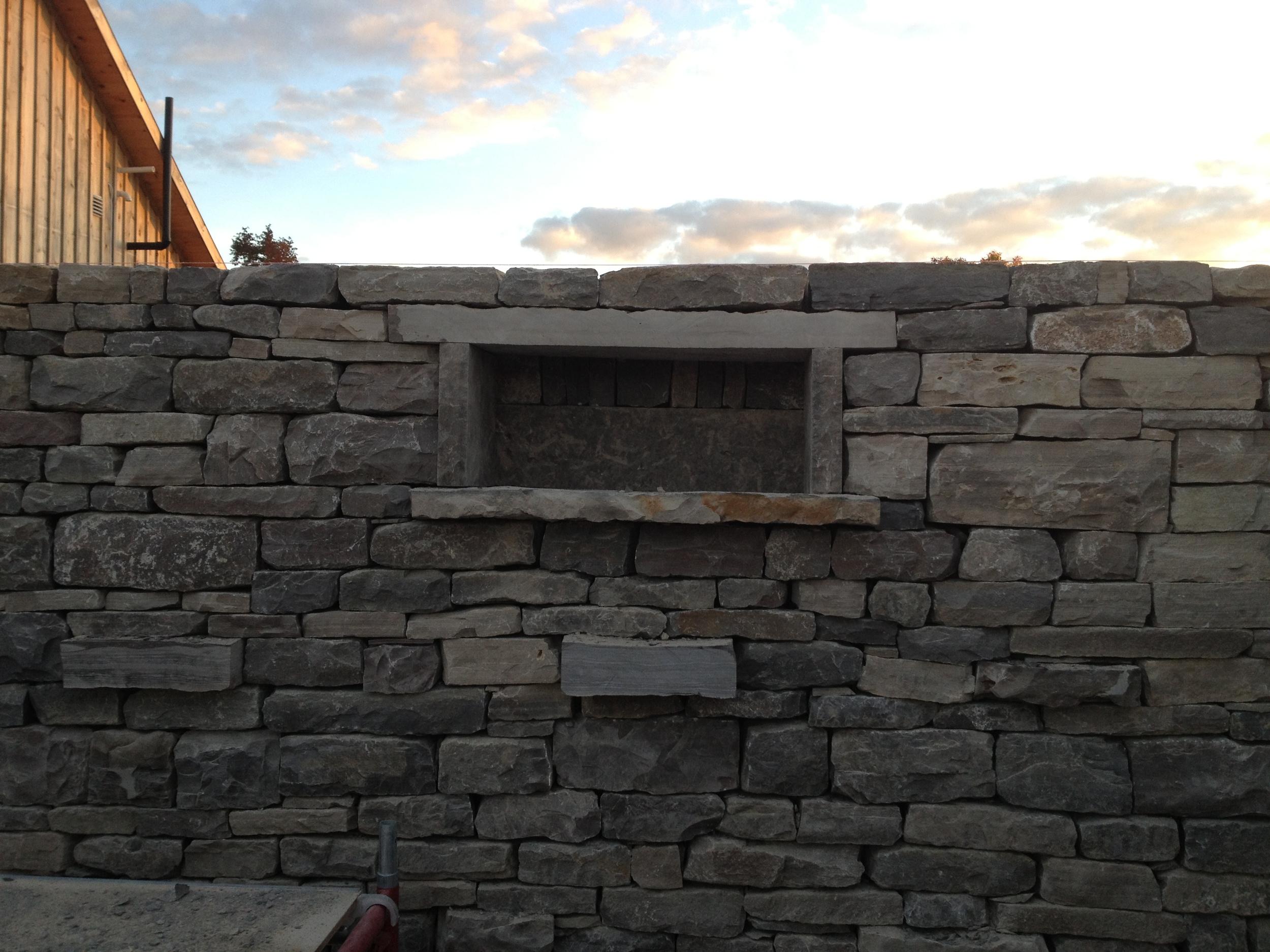 Drystone wall, window and shelving