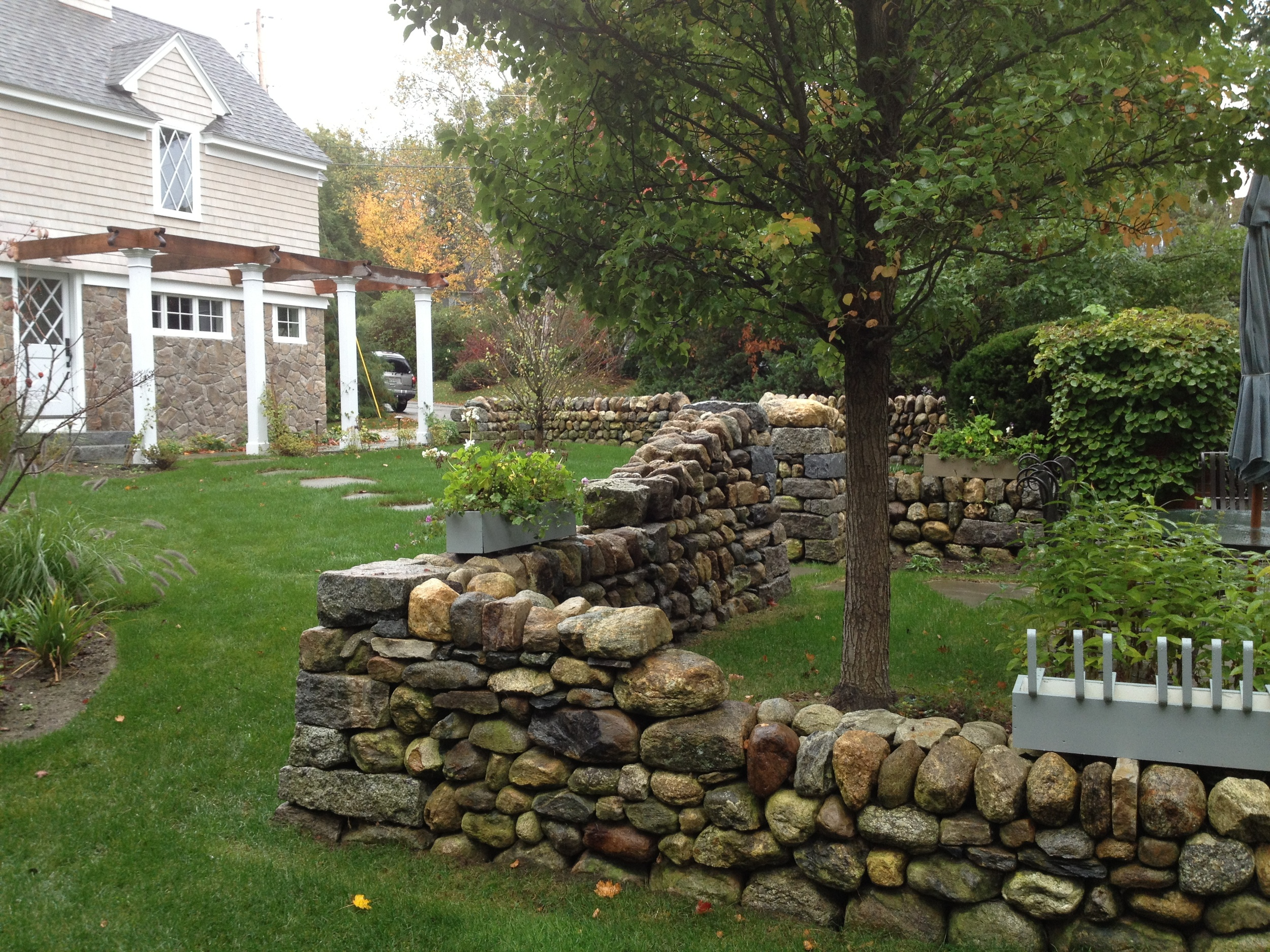 A refurbished drystone wall adds the historic feel of this gardenscape