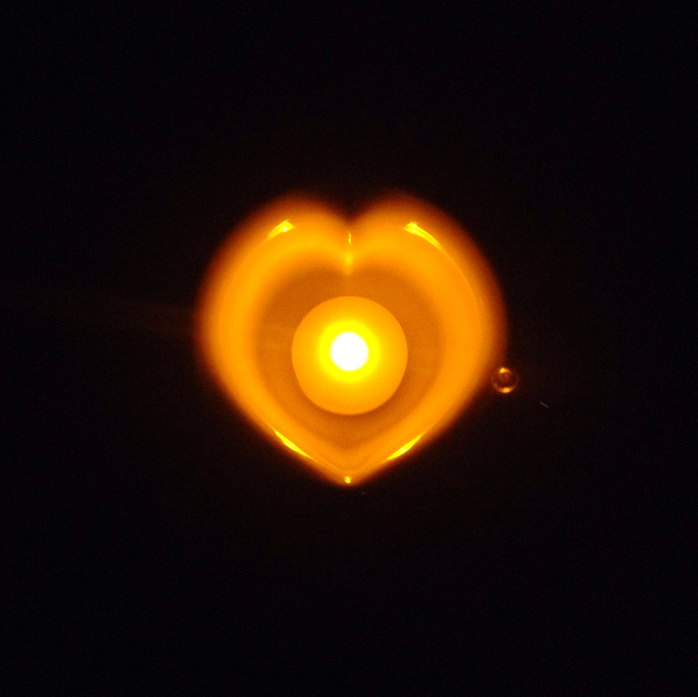 The idea of illuminating one of our lovely heart shaped tea cups with the warmth of a candle came to us from one of our supporters who  brightens up her home (her kitchen) in this way – see the photo above for the glowing light.  A heart shaped tea cup can  brighten up anyone's day!