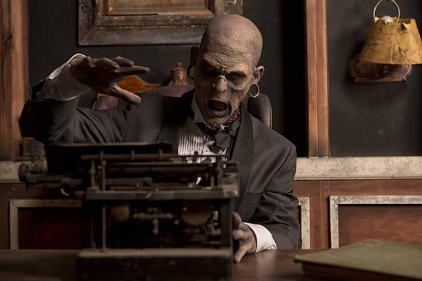 zombie-having-writers-block-picture-id187348543.jpg