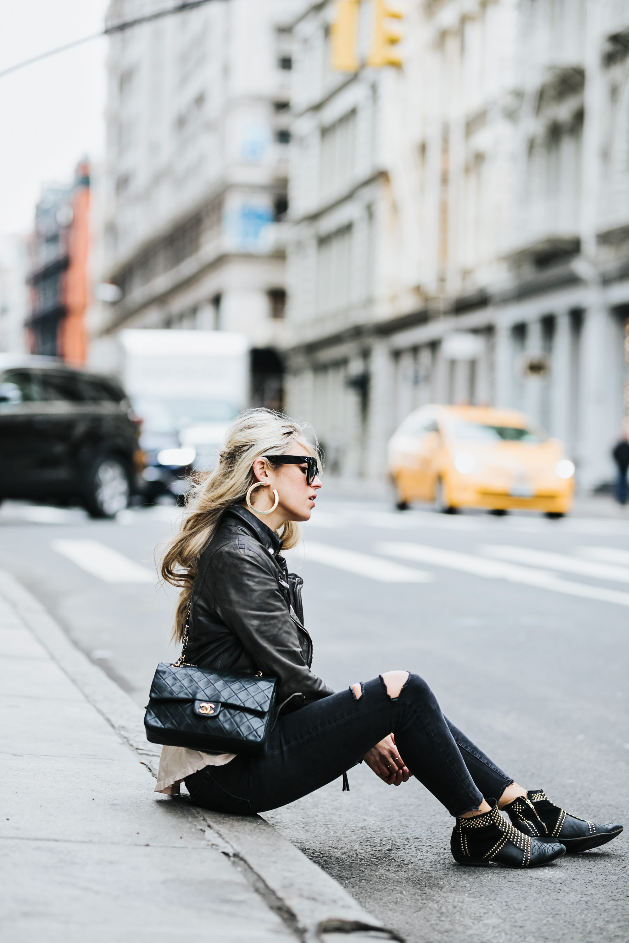 Photography by Allison Kuhl   LOOK 1  Acne  Sweater, JBrand Jeans,  Collage Vintage x Maria Pascual Earrings LOOK 2 Shop Two Songs Tee,  Muubaa  Jacket, Celine Shades,  Anine Bing  Boots