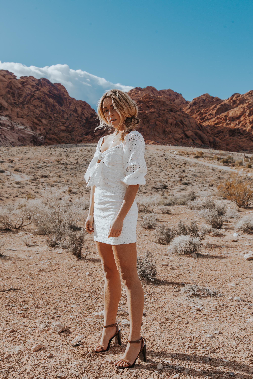 Photos by Paige Owen Levi's Jean Shorts,  Grlfrnd Jacke t Via  Revolve ,  Raye The Label  Boots Via  Revolve  | Jet Set Diaries Dress | Love Shack Fancy Dress | Suboo Dress, YSL Heels