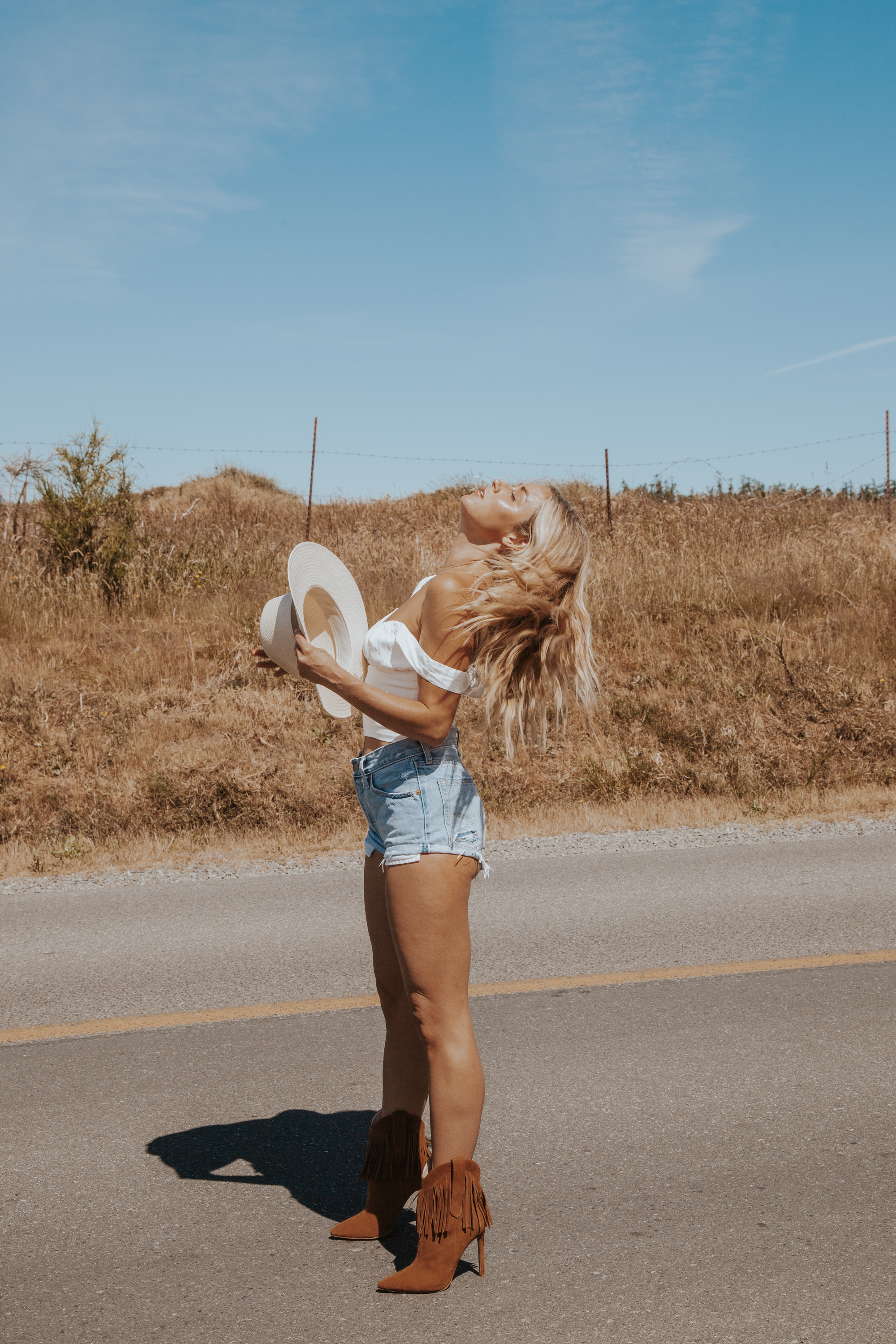 Photos by Paige Owen Boor Hat, With Jean Top, Levi's Shorts, Ray The Label Boots via Revolve