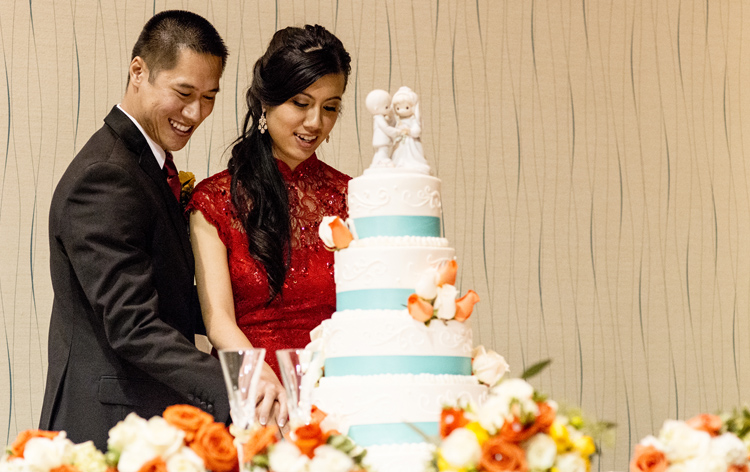 Modern Qipao Cheongsam on real bride at cake-cutting