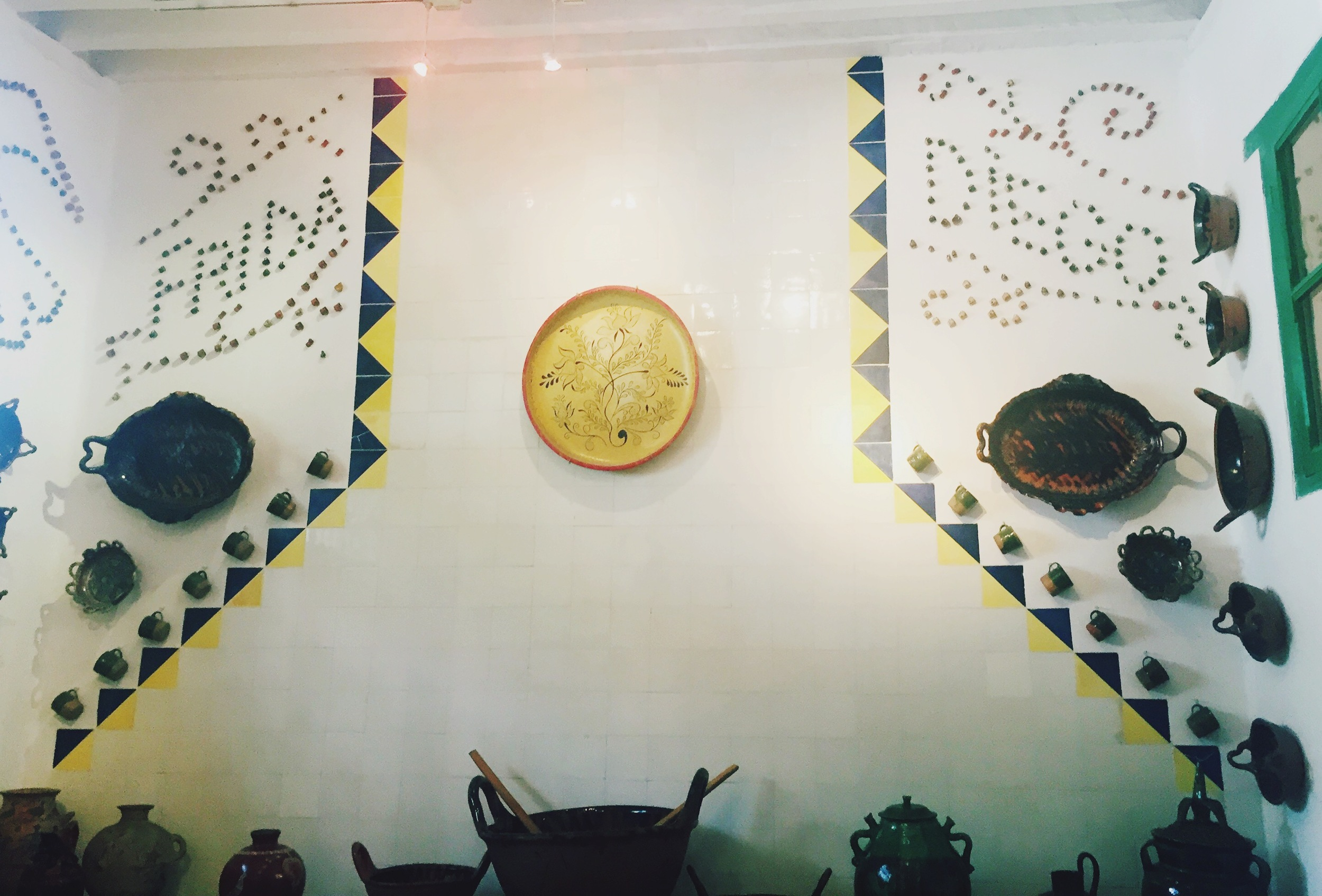 Their kitchen- each wall was covered in beautiful wares and artwork.