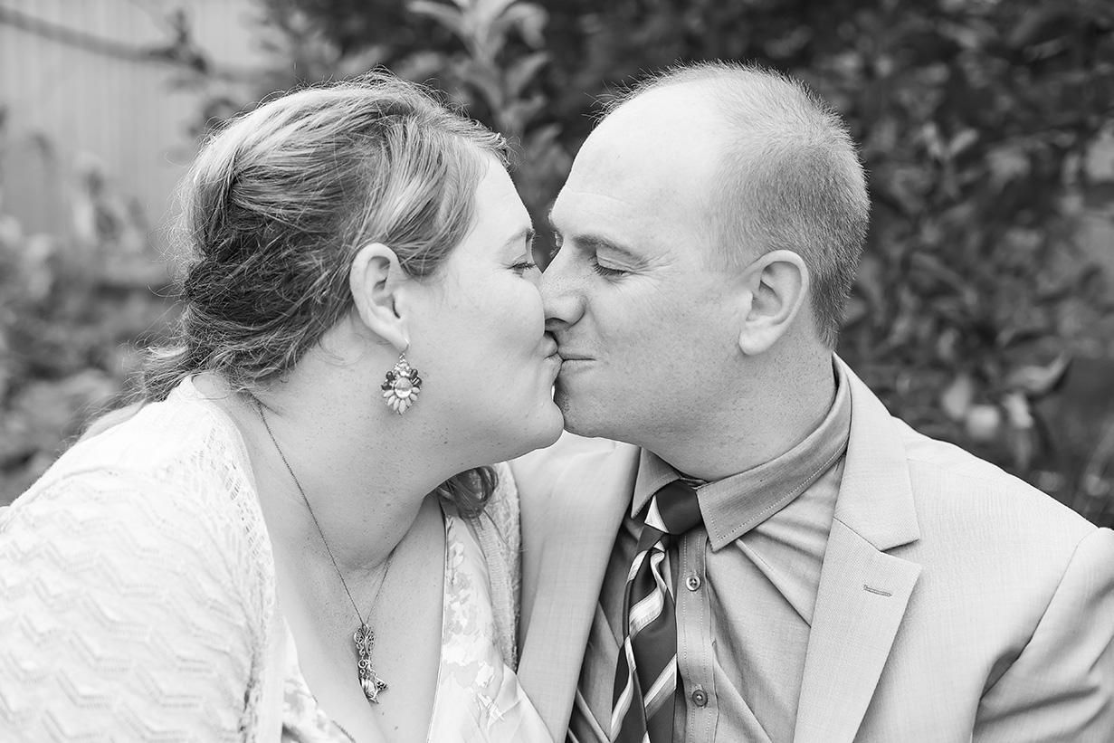 valentines day small backyard wedding portrait black and white kiss