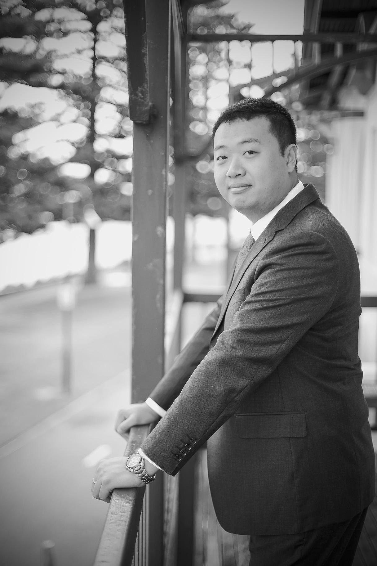 Black and white film style groom preparation photo 1