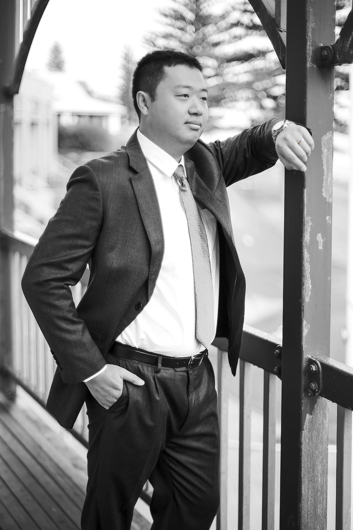 Black and white film style groom preparation photo 2