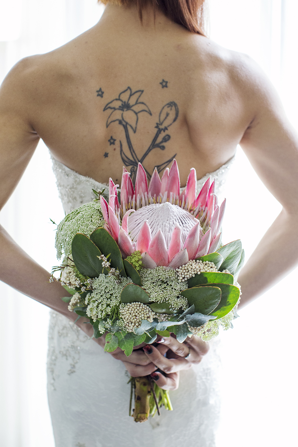 Majestic Rooftop Adelaide Wedding Photography 02 Flowers and back tattoo.jpg