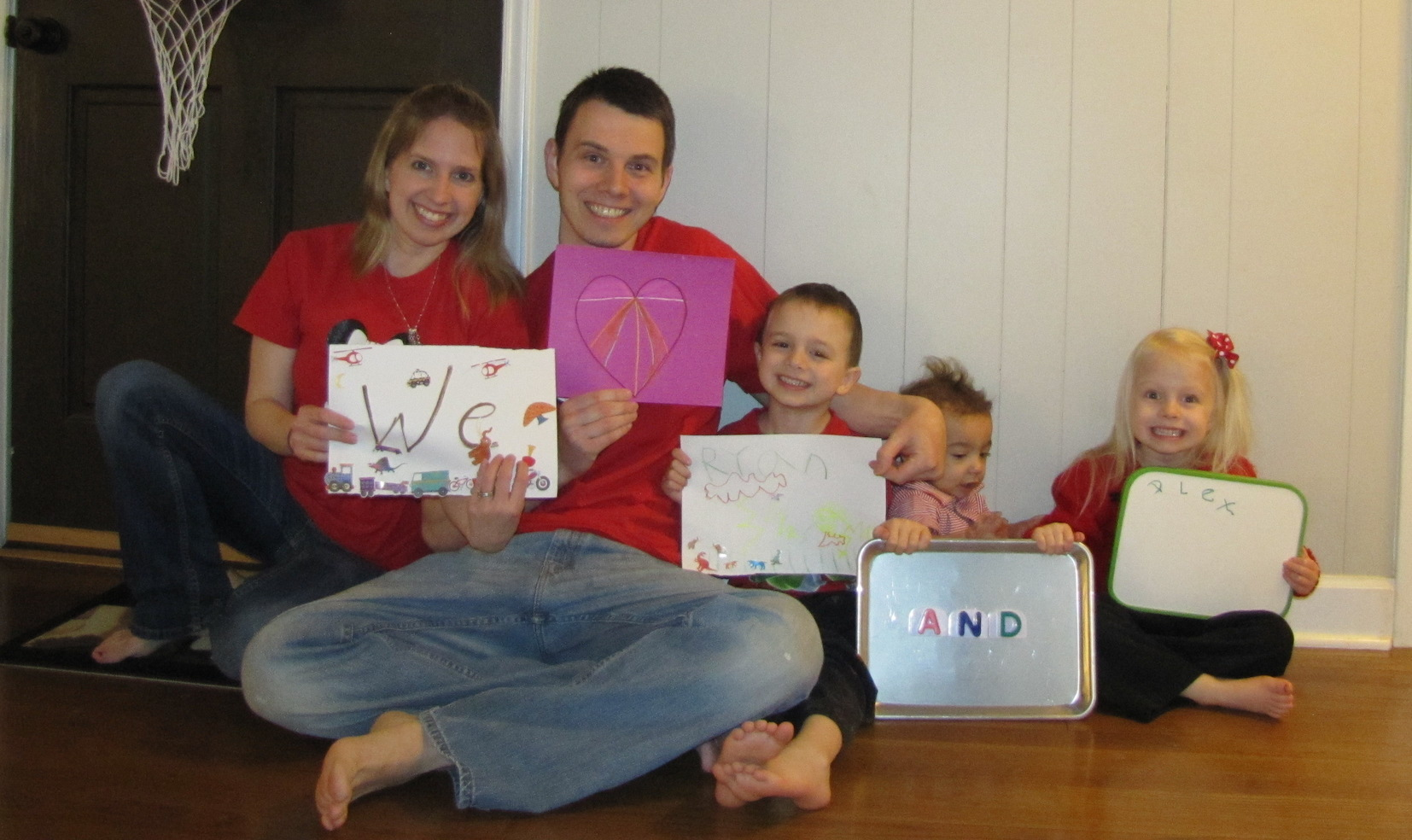 Elizabeth, Mark, Jacob, Lucas, and Ava wear red in memory of Ryan and Alex