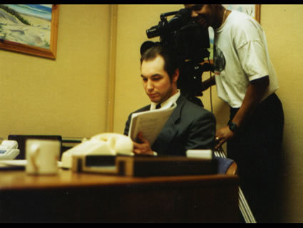 Lead actor, Matt Southwell, goes over his script as Director, David Evans, sets up his next shot.