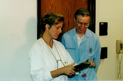 Harold Laymon and Carol Carter play doctor for an upcoming scene.