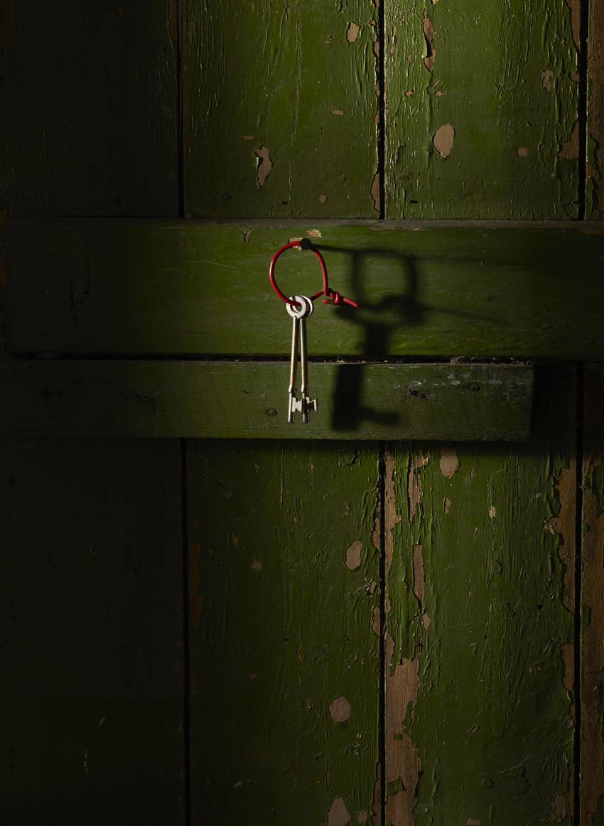 Keys on green door