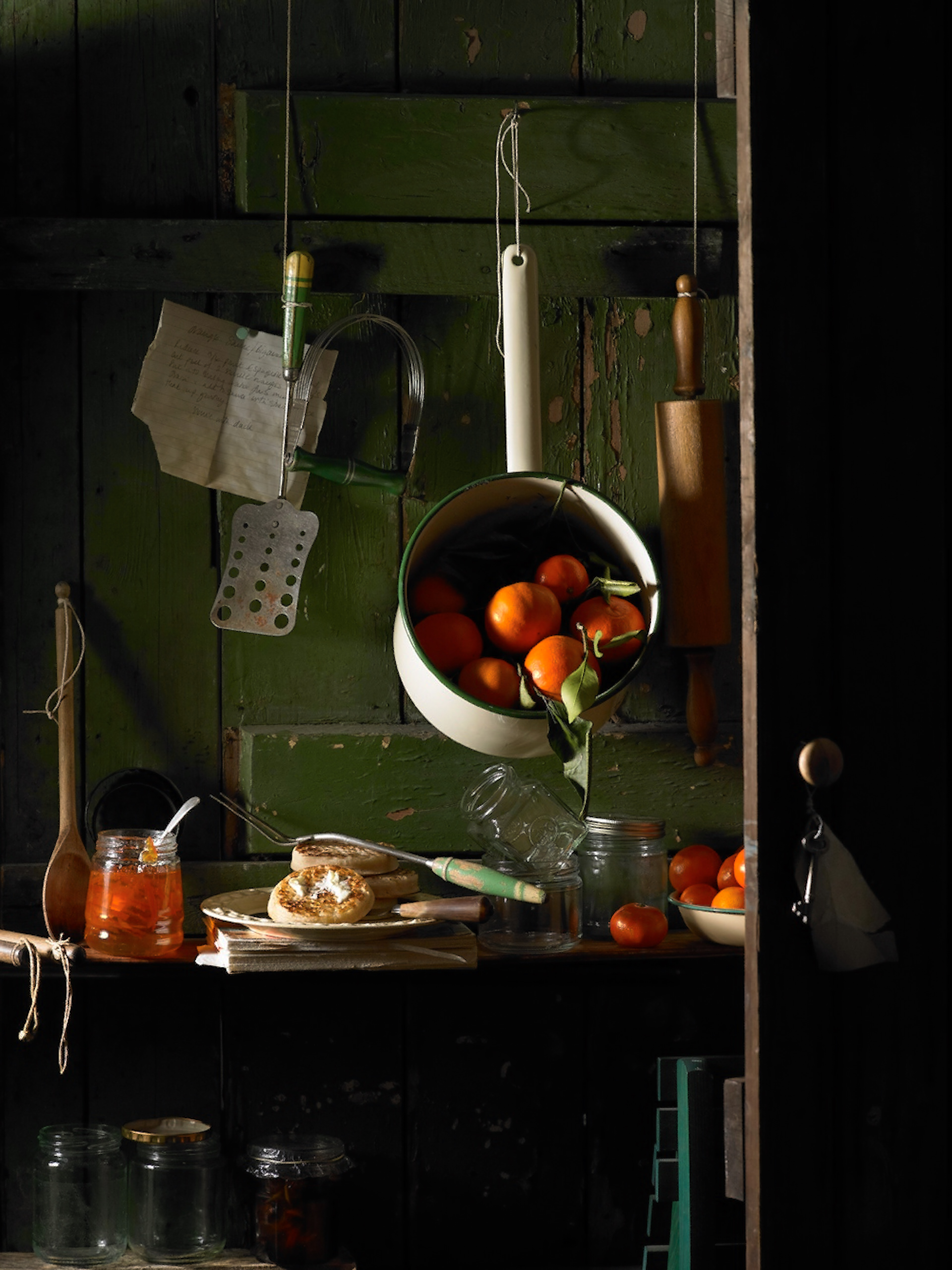 Old kitchen still life with oranges and crumpets