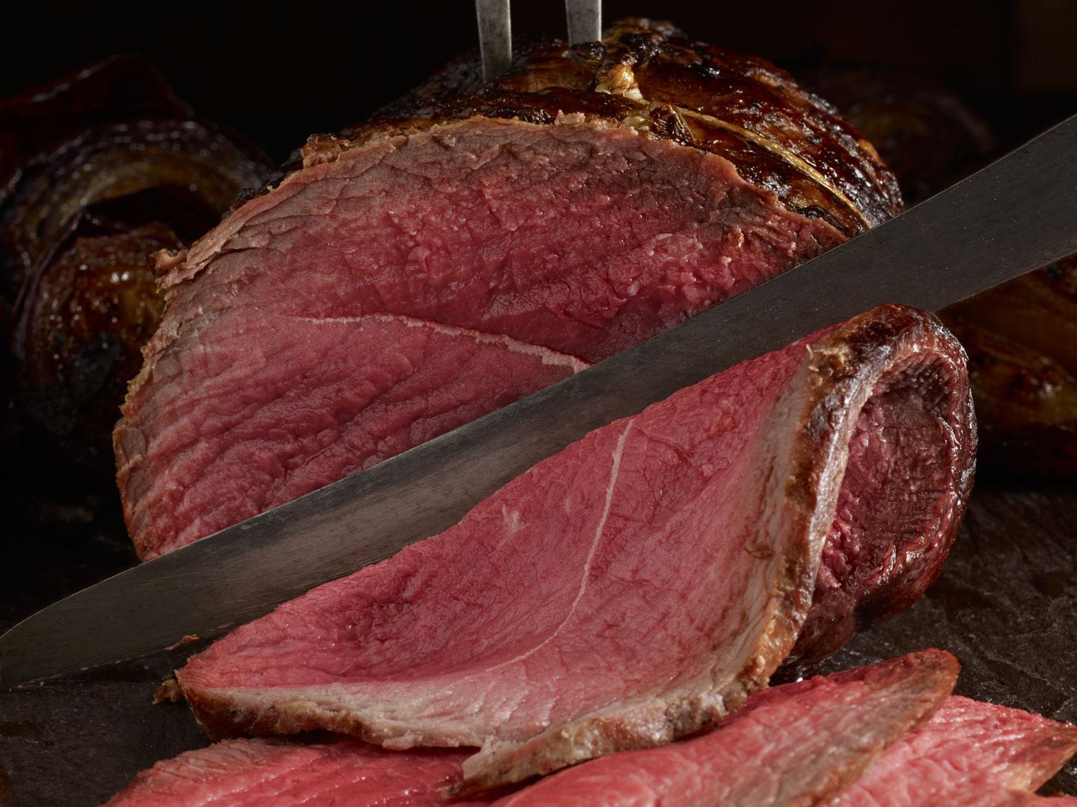 Slicing rare roast beef