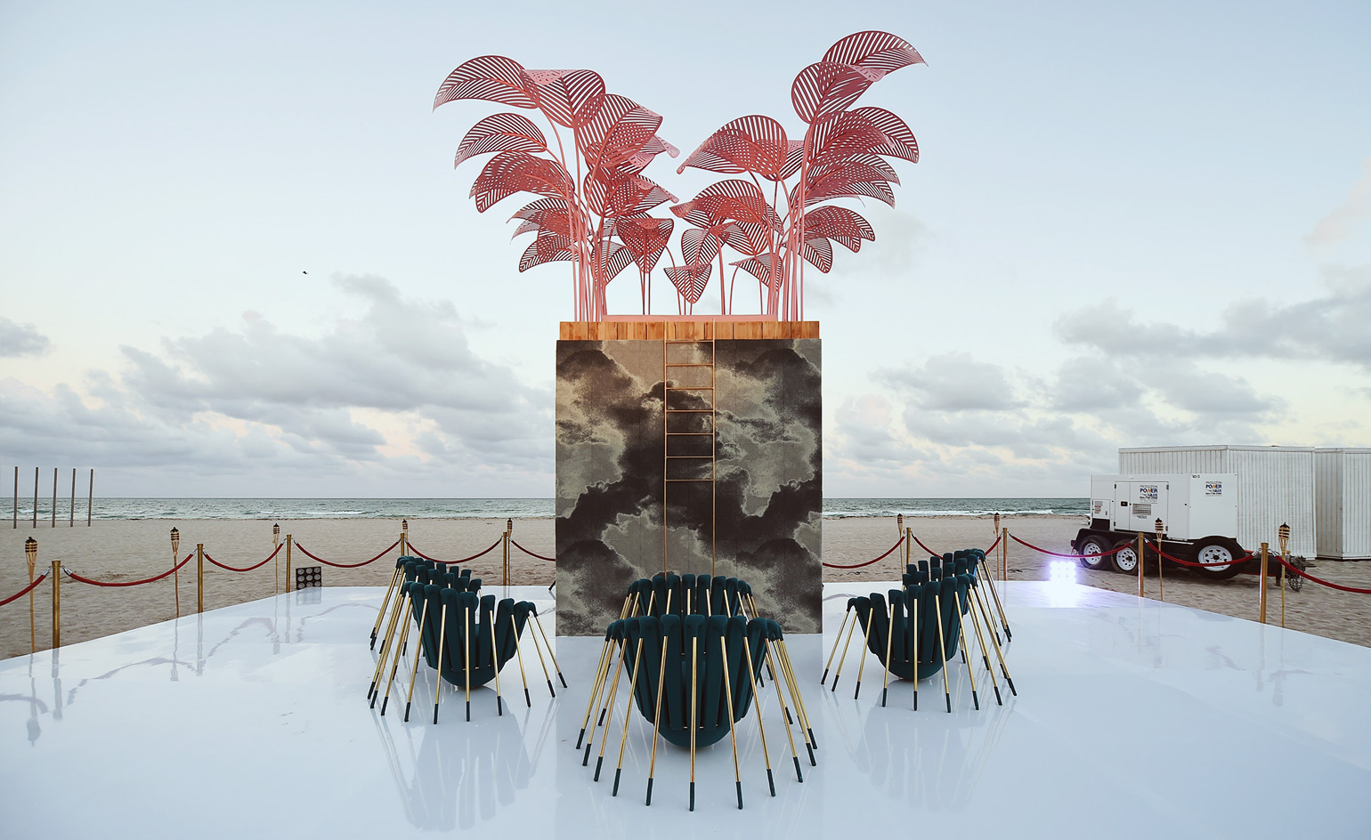 The most instagrammed installation of Salone del Mobile is back: Marc Ange has set his pink oasis, created for Holy Handmade!, to unreachable heights outside the Faena Hotel, and countered it with new pieces, 'Les Araignées'. Polar-opposite in mood, the range of armchairs are covered in Sunbrella fabric and evoke an ominous essence of spiders.